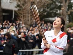 东京奥运会火炬接力在大阪闭门举行