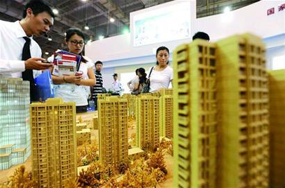 """人民日报:""""高烧""""不会成为楼市新常态,回归理性概率大"""